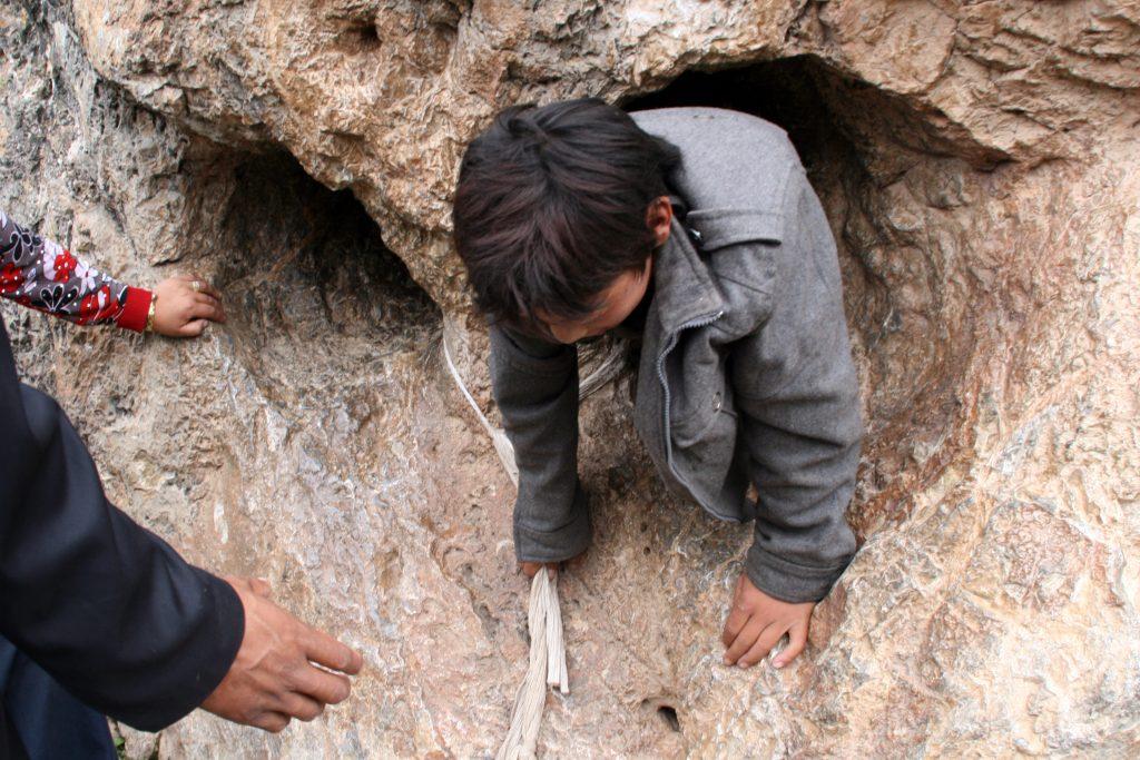 Zhira Gompa Child in the rock