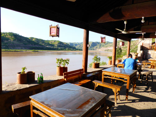 Chilling out with a cold beer by the Yellow River at Qikou