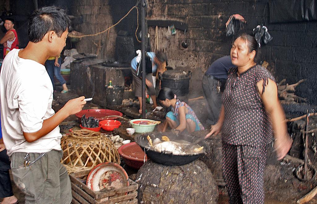 skinning chickens at  Rongjiang Market 榕江市场 Guizhou Province 贵州省