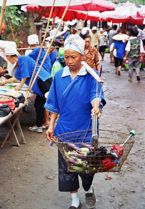 Faces of Chong'an Market Miao lady Shopping in the muddy streets
