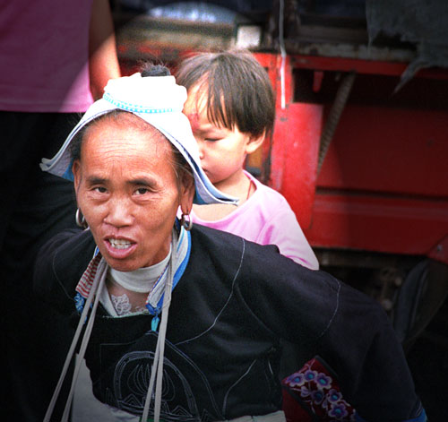 Faces of Chong'an Market Gejia lady with child