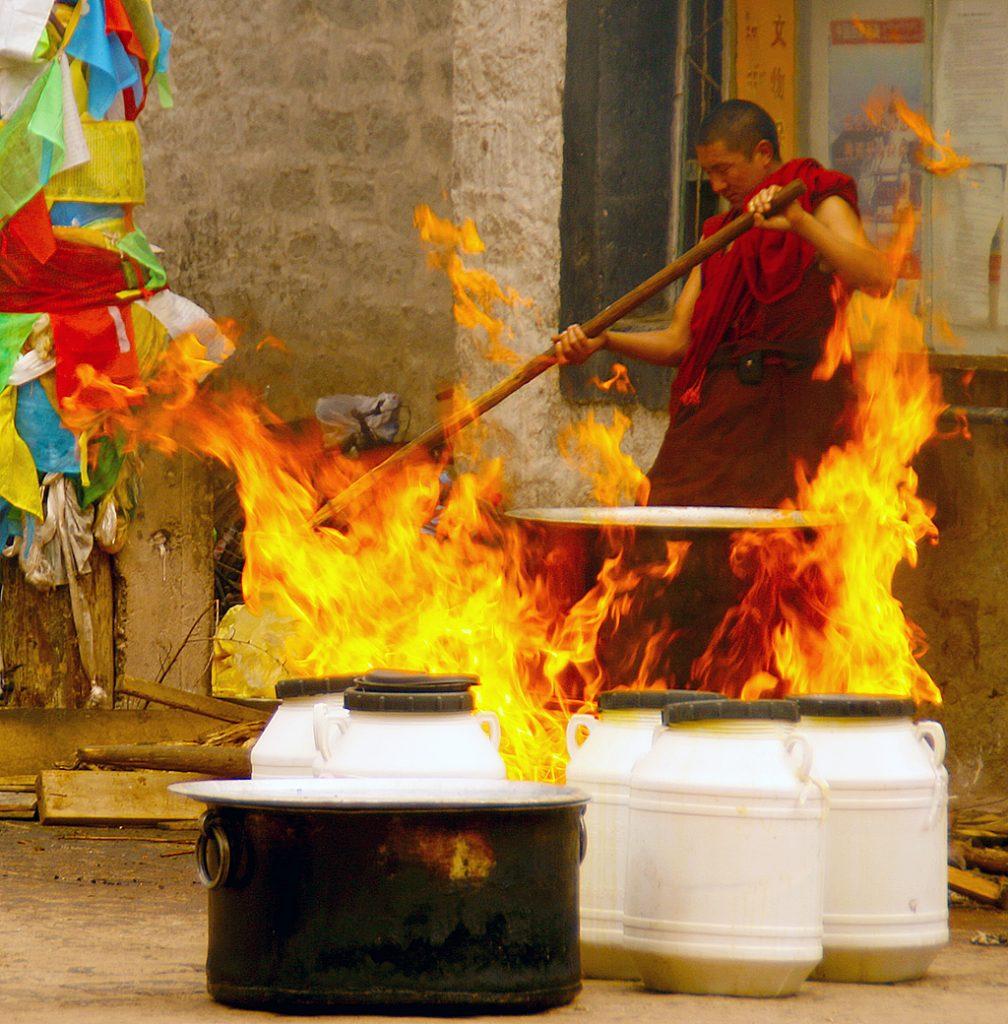 Boiling Yak butter tibetan monk