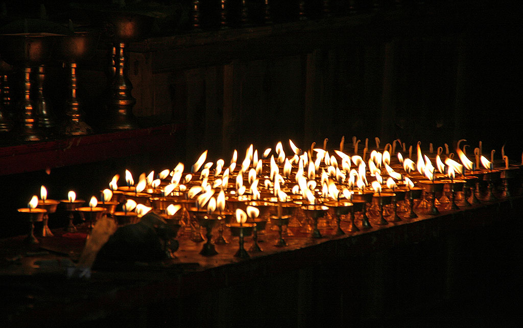 candles at the The Original Yushu Seng-ze Gyanak Mani Wall before the 2009 Earthquake