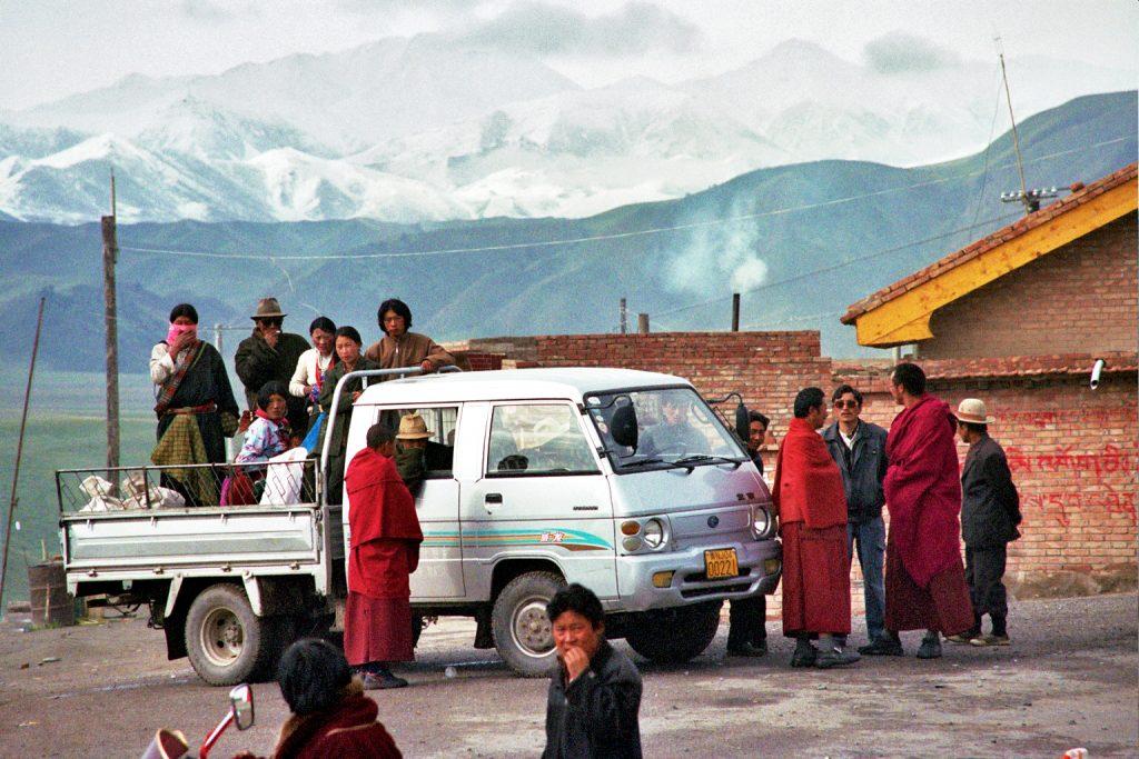 Tibetens waiting for a lift between Gansu and Qinghai provinces