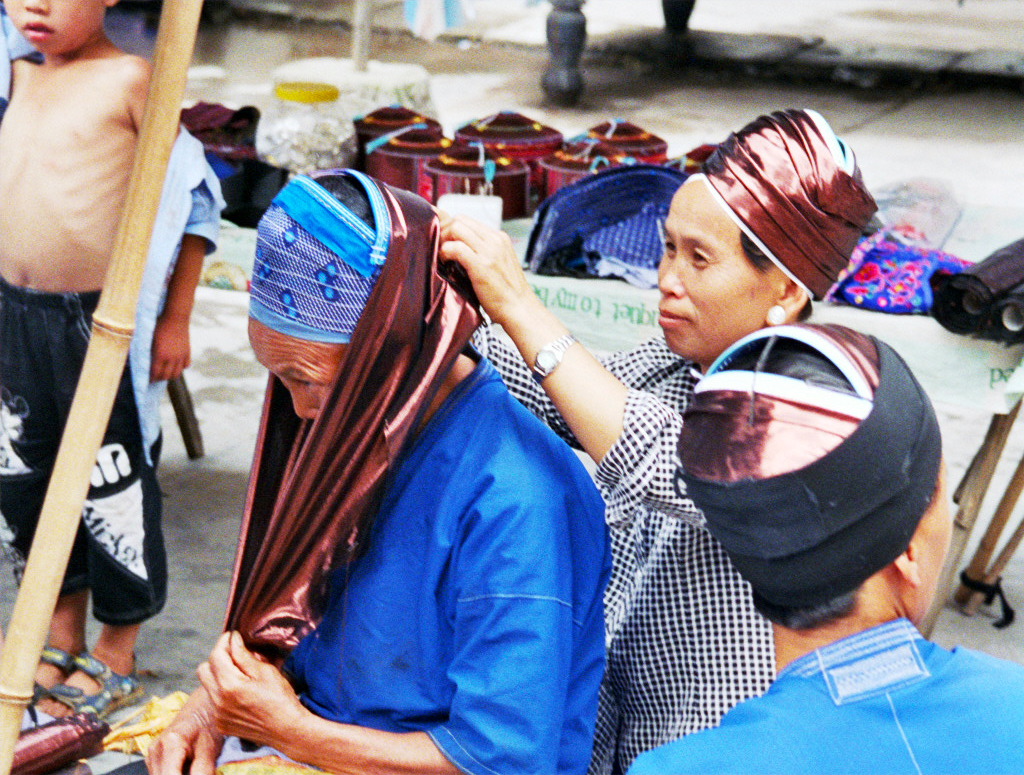 Miao Ladies buying hats
