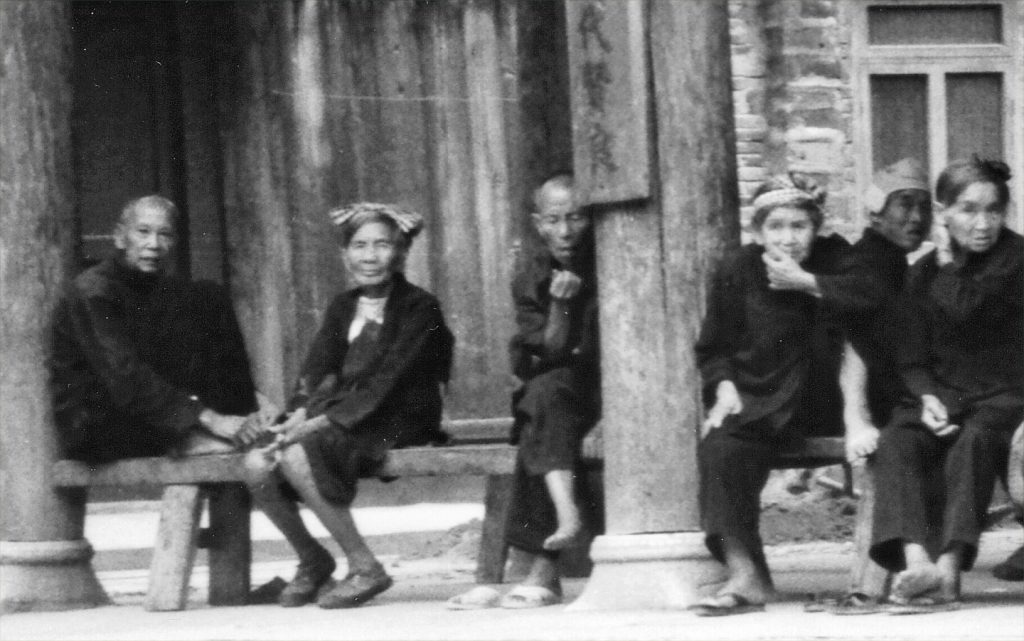 Old Zhaoxing Residents under the main drum tower